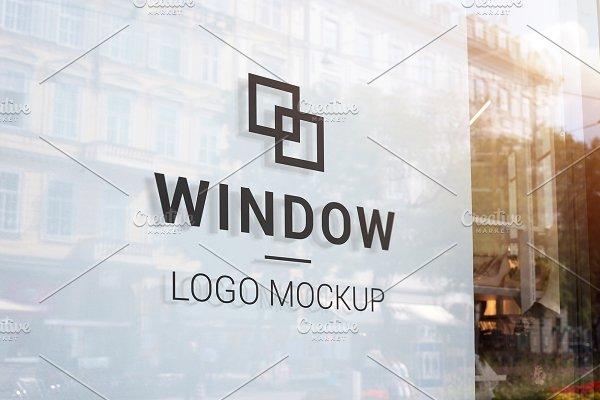 Download Black logo mockup on store window